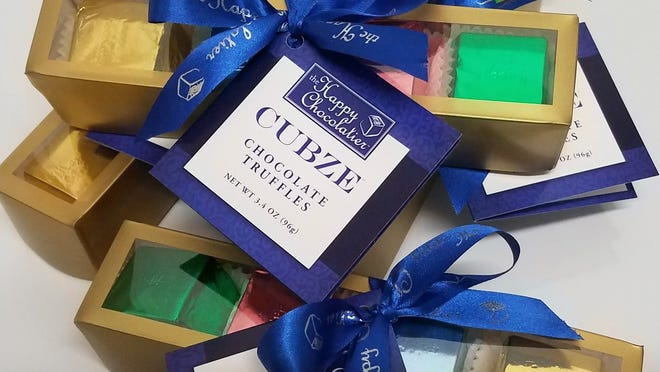 The Happy Chocolatier's cubed truffles are made with high-quality ingredients and are available in a variety of flavors.