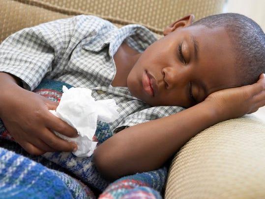 BoySleepingOnCouch.jpg