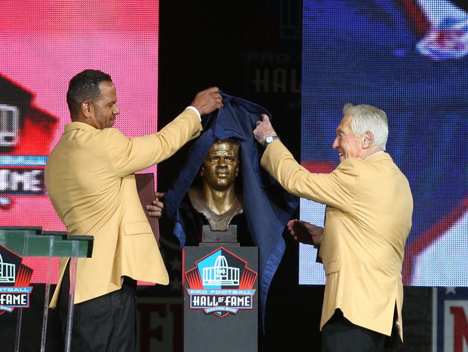 Andre Reed and Marv Levy unveil Reed's Hall of Fame bust Saturday night in Canton.