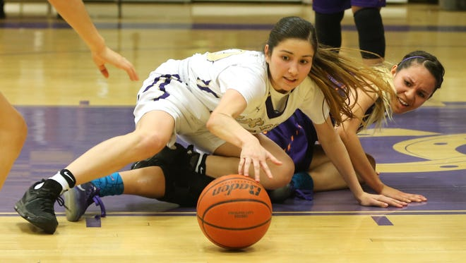 Burges' Natalie Sanchez, left, and Eastlake's Alexia Gonzalez battled to reach the loose basketball during a game this season.
