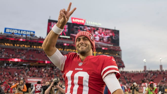 San Francisco 49ers quarterback Jimmy Garoppolo (10) celebrates after the game against the Jacksonville Jaguars at Levi's Stadium.