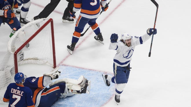 Tampa Bay Lightning's Brayden Point (21) celebrates his goal against New York Islanders goalie Semyon Varlamov (40) during the third period of an NHL Eastern Conference final playoff game in Edmonton, Alberta, on Sunday, Sept. 13, 2020.