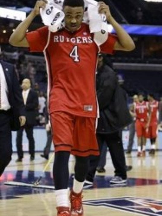 Rutgers guard Myles Mack leaves the court after his team's loss to Louisville on Thursday in the quarterfinals of the American Athletic Conference tournament in Memphis. (AP)