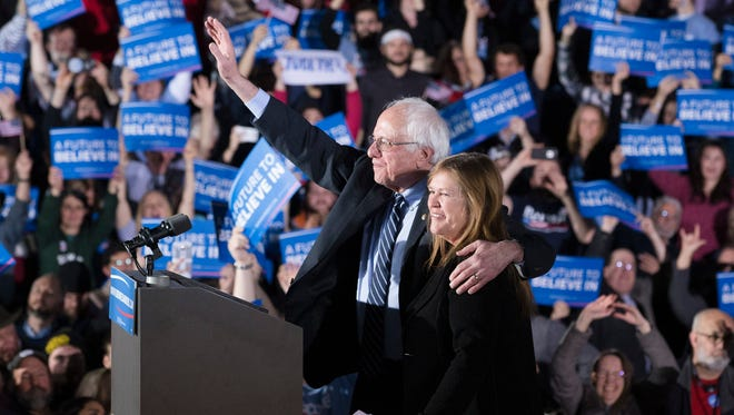 Democratic presidential candidate Sen. Bernie Sanders, I-Vt., and his wife Jane celebrate after speaking during a primary night watch party Tuesday at Concord High School in Concord, N.H.