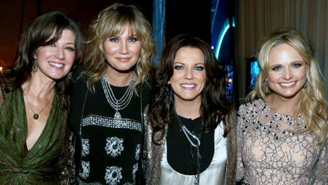 Singers Amy Grant, Jennifer Nettles, Martina McBride and Miranda Lambert at the 2014 MusiCares Person Of The Year awards Jan. 24, 2014, in Los Angeles.