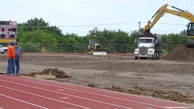Mounds of dirt was taken off the football and soccer fields as they are being prepped for turf. Ottawa school district officials anticipate a mid-August completion rate, a couple of weeks cushion before the fall seasons begin. [PHOTO BY GREG MAST/THE OTTAWA HERALD].