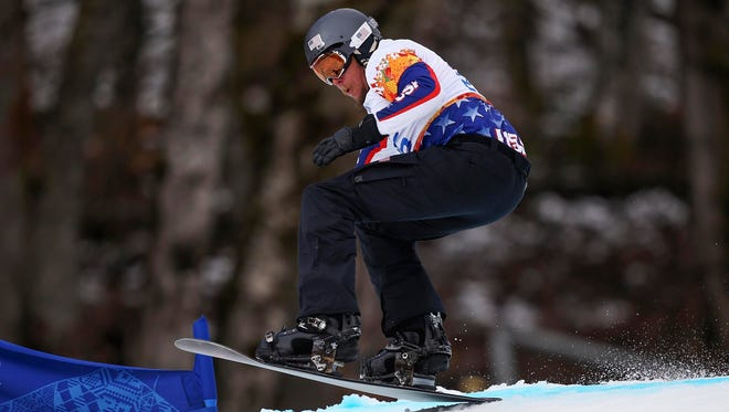 Tyler Burdick of the United States competes during the men's para-snowboard cross at the Sochi Paralympic Games at Rosa Khutor Alpine Center on March 14.