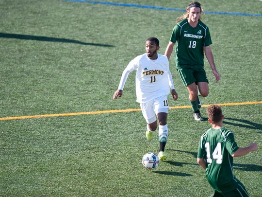 Vermont's Geo Alves, center, looks to pass the ball to a teammate during Saturday's men's soccer game against Binghamton at Virtue Field.