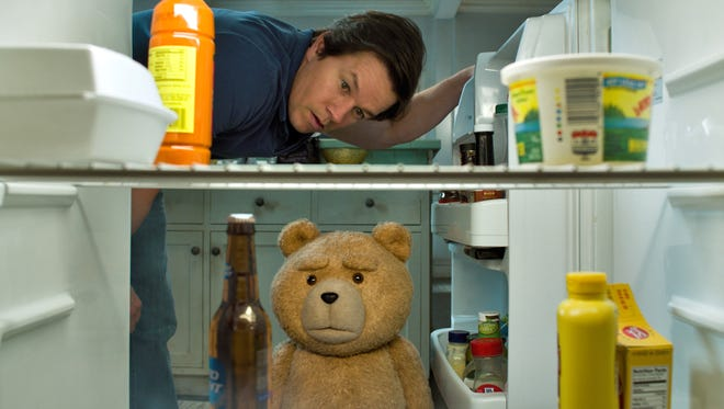 John (Mark Wahlberg) and Ted (voiced by Seth MacFarlane) raid the fridge in 'Ted 2.'