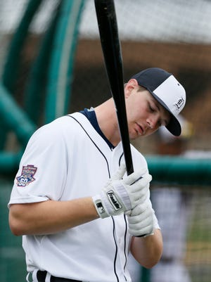 Detroit Tigers catcher Grayson Greiner checks out his batting grip during full-squad workouts at spring training Feb. 26, 2015, in Lakeland, Fla.