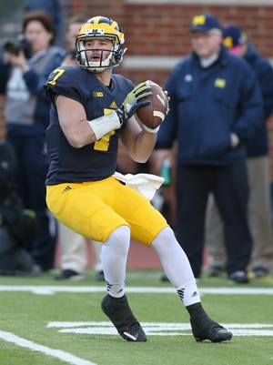 The University of Michigan Wolverines Shane Morris throws a touchdown to Drake Johnson during first half action of the Spring Game on Friday, April 1, 2016 at Michigan Stadium in Ann Arbor Michigan.