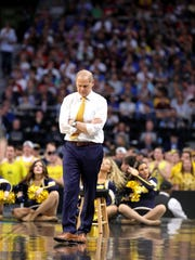 Michigan coach John Beilein walks the sideline during the NCAA men's semifinal against Loyola-Chicago on on March 31, 2018, in San Antonio.
