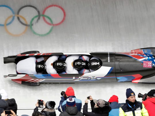 Driver Nick Cunningham, Hakeem Abdul-Saboor, Christopher Kinney, Samuel Michner of the United States take a curve in the second heat of the four-man bobsled competition at the 2018 Winter Olympics in Pyeongchang, South Korea, Saturday, Feb. 24, 2018. (AP Photo/Michael Sohn)