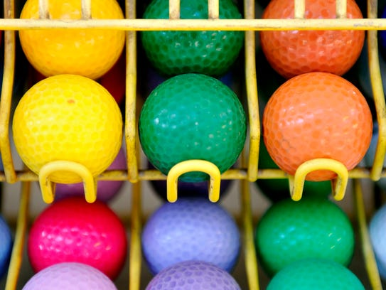 Colorful golf balls are on display.