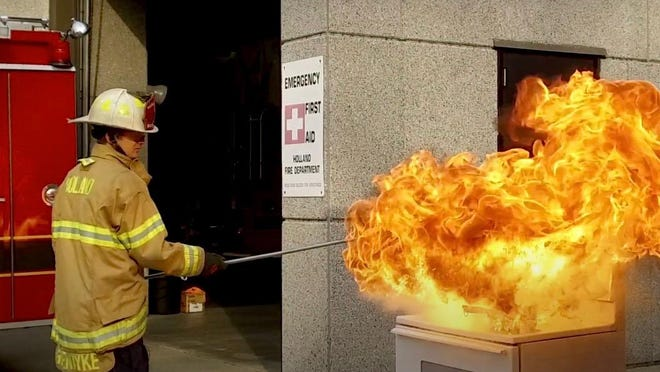 In this screenshot from the city of Holland's kitchen safety demonstration video, Fire Marshal Bret Groendyke demonstrates how dangerous stovetop fires can be.