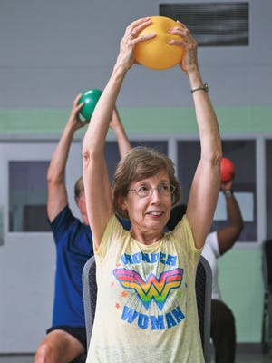 Women work out during a SilverSneakers class in Kentucky. The program is now available in Mesquite.
