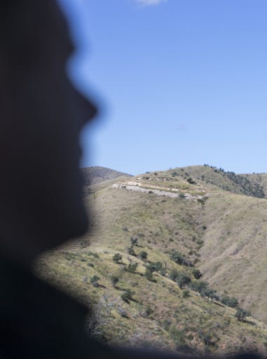Border Patrol agent John P. Lawson, drives along the border fence west of Nogales, where surveillance cameras, radar, ground sensors and other technology has made it harder for people to enter illegally and not get caught.