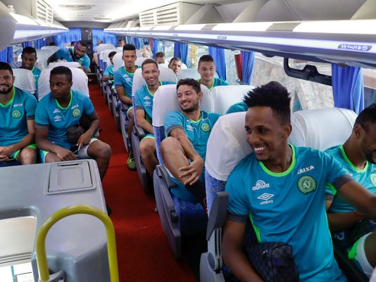 The new Chapecoense soccer team sits in a bus on their way to a training session in Chapeco, Brazil, Wednesday, Jan. 18, 2017. Three Chapecoense players survived and 19 players perished in an air crash that killed 71 people almost two months ago in Colombia. (AP Photo/Andre Penner)