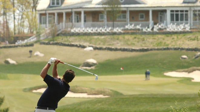"""A golfer tees off at Shelter Harbor Golf Club in Charlestown. The club was among several in Rhode Island that received between $350,000 and $1 million in forgivable """"small business"""" loans from the federal government's $660-billion Paycheck Protection Program."""