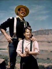 Patrick Wayne and John Wayne on the set of John Ford's