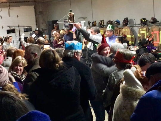 Revelers during the Princess Anne muskrat drop, in the last moments of 2017.