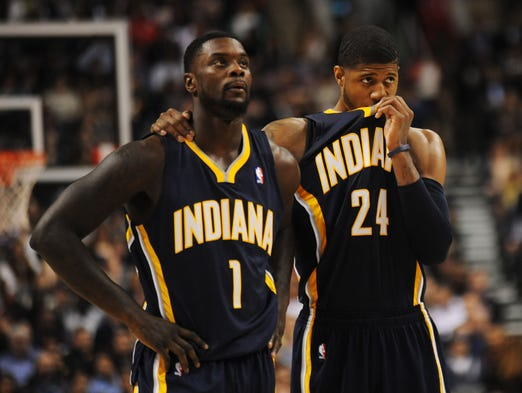 Apr 4, 2014; Toronto, Ontario, CAN; Indiana Pacers Lance Stephenson and Paul George look on dejectedly as the Toronto Raptors take a free throw during the second half at Air Canada Centre. Mandatory Credit: Dan Hamilton-USA TODAY Sports
