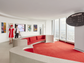 A sunken lounge carpeted in Chili Pepper Red, the signature