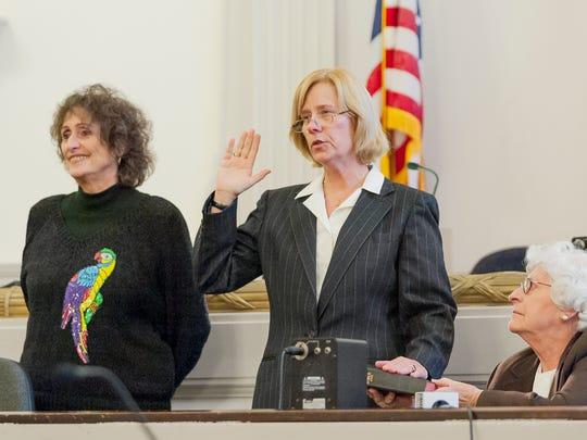 Tompkins County District Attorney Gwen Wilkinson, center,