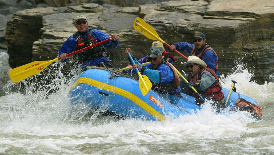 Rafters hit white water on the Salt River 40 miles
