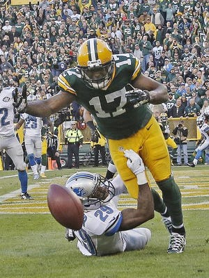 Asheville native Crezdon Butler, bottom, made a play that helped the Lions beat the Packers on Sunday.