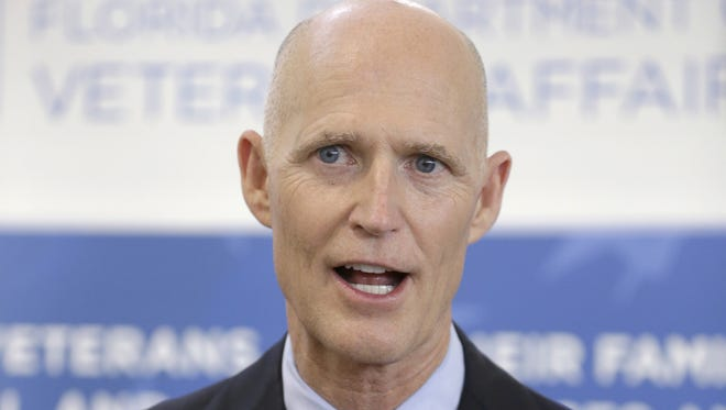 "Gov. Rick Scott FILE- In this April 29, 2014 file photo, Florida Gov. Rick Scott speaks to members of the media after a ceremony during which he presented ""Governor's Veterans Service Award,"" medals to veterans in Fort Lauderdale, Fla. Gov. Scottâ??s campaign for re-election is hitting Democratic rival Charlie Crist with a barrage of attacks but his campaign team has also committed a series of blunders this year. (AP Photo, File)"