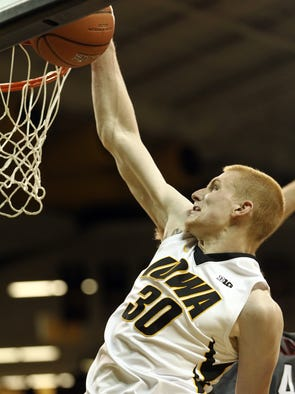 Iowa's Aaron White goes up for a dunk after being fouled by Nebraska-Omaha's Matt Hagerbaumer during their game at Carver-Hawkeye Arena on Sunday, Nov. 10, 2013.