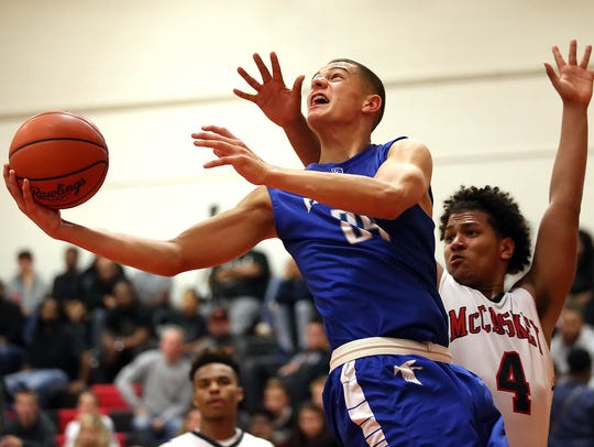 Cedar Crest's Cole Laney (25) goes to the hoop as McCaskey's