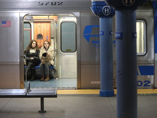 Commuters are shown at the Hoboken PATH station in a train that goes to midtown, Thursday, January 5, 2016.