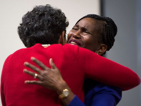 Valeria Steele-Roberson hugs Mary Palmer after a women's