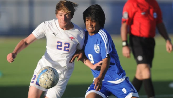 Cooper's Noah Carr (22) battles Amarillo Palo Duro's Win Thein (9) for the ball. Palo Duro won the Region I-5A bi-district playoff game 3-2 in overtime Friday, March 24, 2017 at Frenship's Tiger Soccer Stadium in Wolfforth.