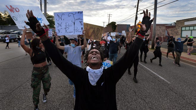 Protesters march on South Florissant Road in front of the Ferguson police station on May 30, demonstrating against the death of George Floyd in custody of Minneapolis police officers.
