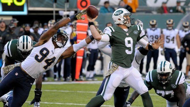 New York Jets quarterback Bryce Petty (9) throws under pressure from Los Angeles Rams defensive end Robert Quinn (94) during the third quarter of an NFL football game, Sunday, Nov. 13, 2016, in East Rutherford, N.J.