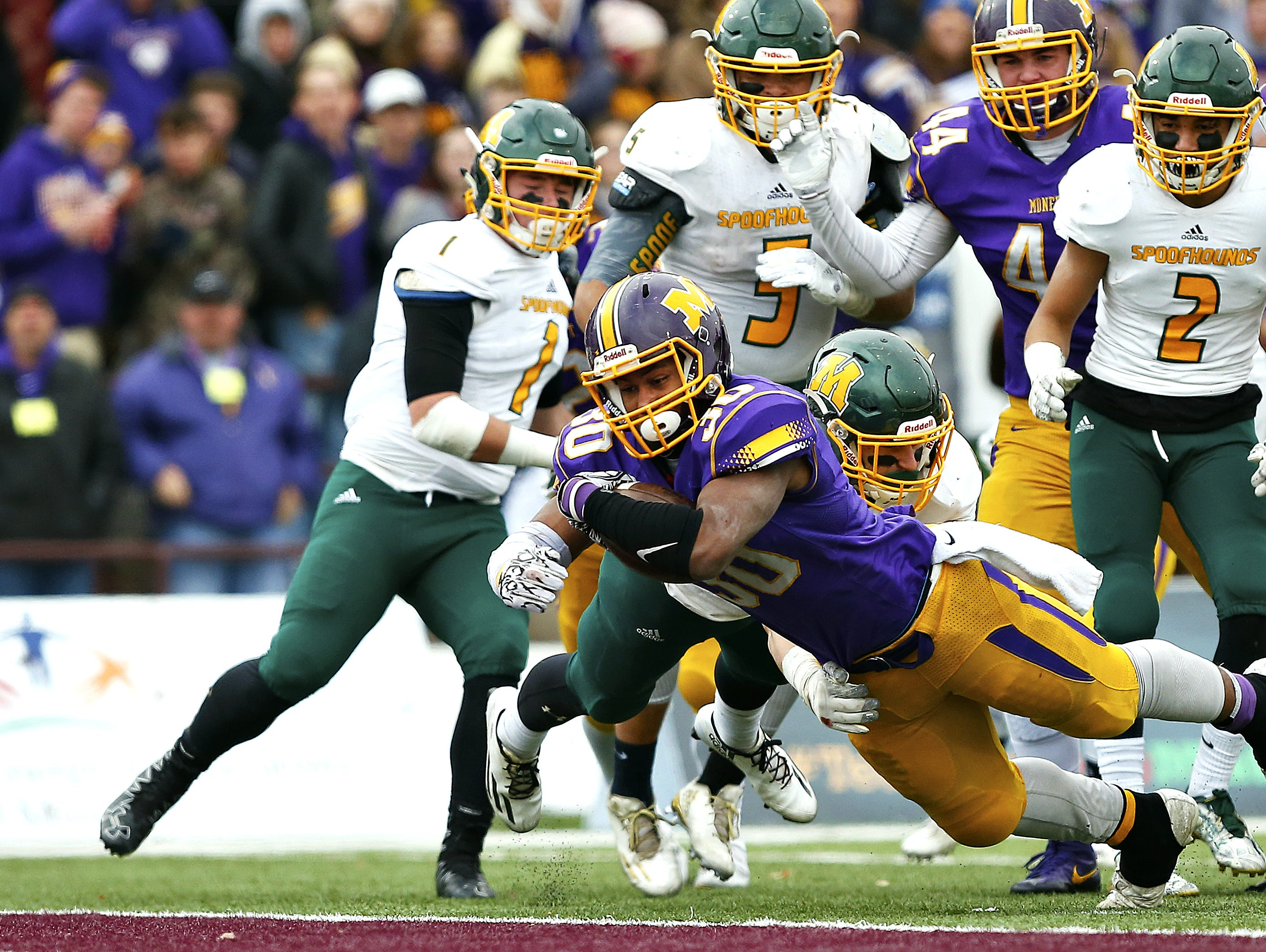 Monett High School running back Michael Branch (30) dives toward the end zone to score a touchdown during the third quarter of the 2016 Missouri Class 3 state championship game between Monett and Maryville at Plaster Stadium. The Cubs won the game 27-18.