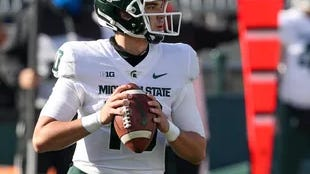 Michigan State's Payton Thorne looks down field against Penn State.
