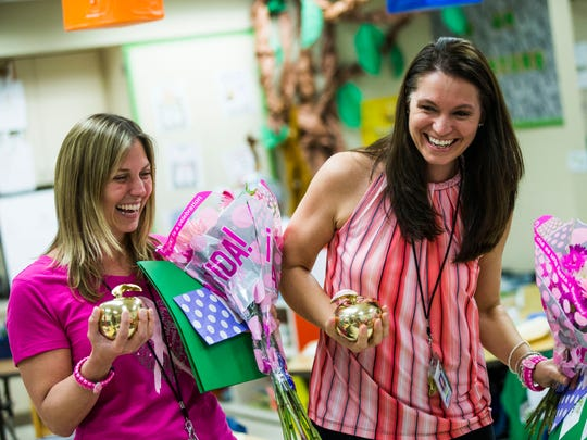 Joanna Campanile, left, and Janell Matos celebrate after receiving Golden Apple awards at Poinciana Elementary School on Tuesday, Feb. 14, 2017. Every year Champions for Learning gives out the awards for best teaching practices.