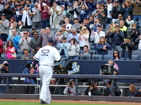 New York Yankees starting pitcher CC Sabathia (52) walks off to a standing ovation during the sixth inning against the Toronto Blue Jays at Yankee Stadium on Saturday, Sept. 30,. 2017.