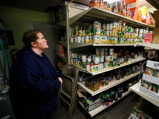 Theresa Callahan, CCR Coordinator in the pantry where
