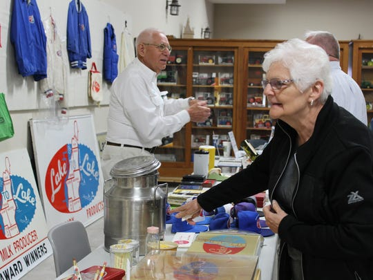 Visitors admire the collection of Lake to Lake Dairy Cooperative memorabilia at the Agricultural Heritage and Resources Center in Kewaunee on May 19.