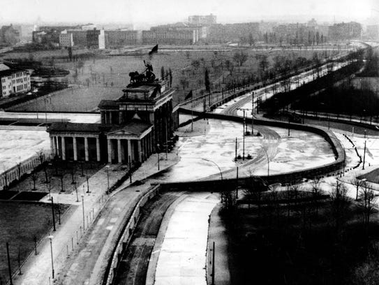 The Brandenburg Gate is sealed off in the Soviet-occupied sector of East Berlin, Germany, in November 1961. Located at the center of the German capital, the gate stands behind part of the Berlin Wall that divides East and West Berlin.