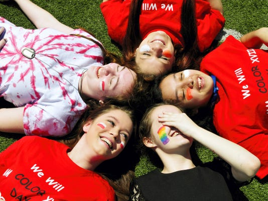 CASHS freshman, clockwise, Theresa Fala, Maria Hernandez, Cassandra Clevenger, Yamiletta Garcia and Sera Elgin hang out under the sun Friday during Chambersburg Area Senior High School's annual Color Day at the school.