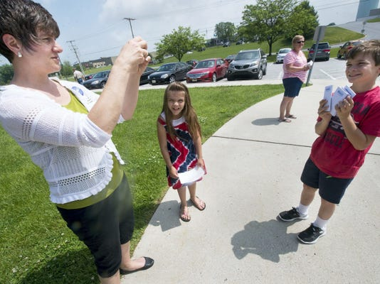 Joanna Hoy, of Manchester Township, takes a photo of her son Jonathan, 10, right, while her daughter Alexa, 8, looks on at the Manchester Township municipal building polling place. The family came out to campaign for Chris Menges for county judge, and since the children are home-schooled, it was incorporated into their civics lessons.