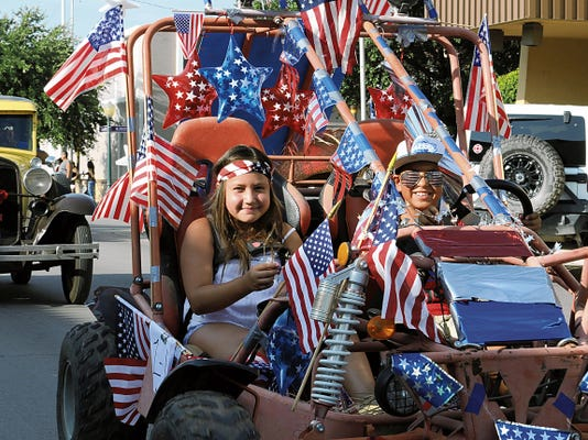 JESSICA ONSUREZ CURRENT-ARGUS   The Carlsbad Fourth of July parade was full of fun and family, and not to mention the American flag. Around 30 entires participated in the parade which traveled through the downtown area Saturday morning and kicked off the holiday activities in Carlsbad.