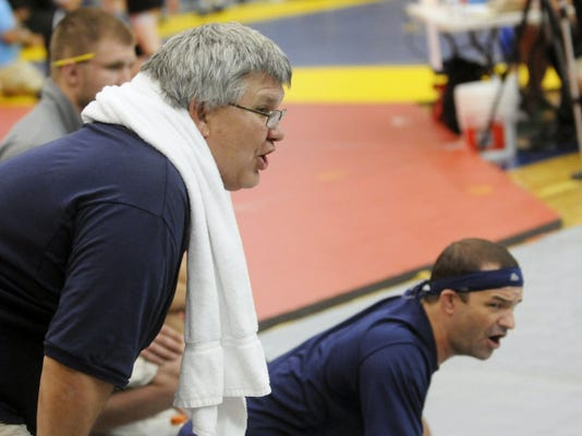 Chambersburg wrestling coach Doug Rine, left, has stepped down after 20 years of coaching the Trojans.