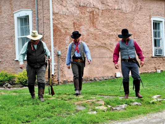 Billy the Kid and two of his fellow Regulators prepare for a gun battle during a 2014 reenactment of the Lincoln County War. The performance was part of Old Lincoln Days at the historic town.